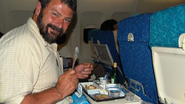 Rick's producer, Simon, enjoying a in-flight meal