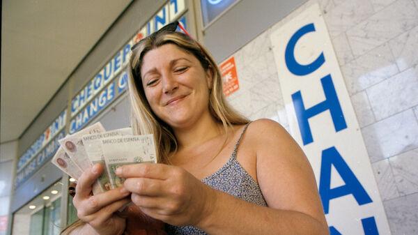Lady making change in pesetas, Spain
