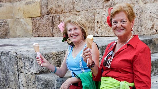Two ladies eating ice cream in Córdoba, Spain