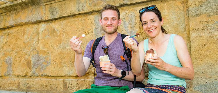 Couple eating ice cream in Pienza, Italy