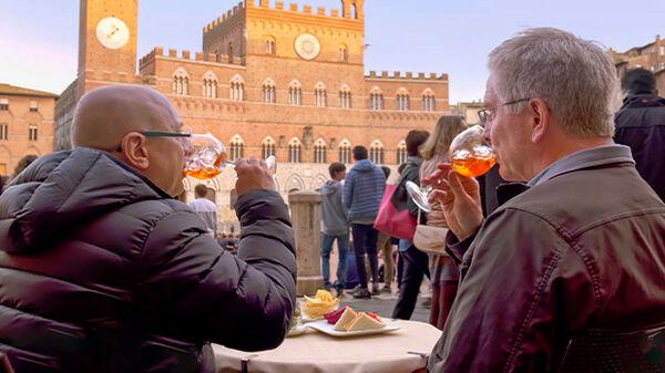 Rick and guide Roberto enjoying an aperitivo, Siena, Italy