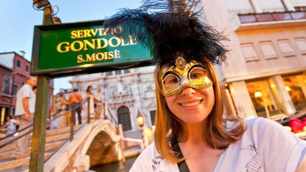 Wearing a Venetian mask