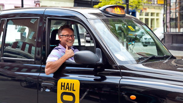 London taxi driver giving thumbs-up sign