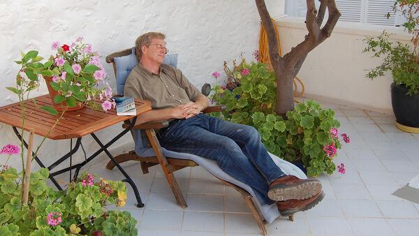 Rick Steves taking a nap in Hydra, Greece