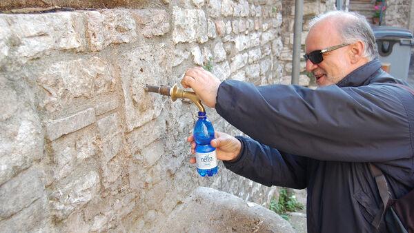 Man filling up a water bottle