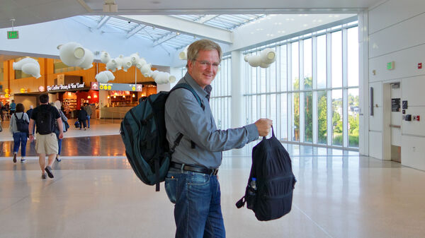 Rick Steves at the airport with his carry-on luggage