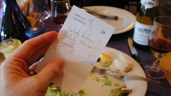 Handwritten receipt in Paris restaurant
