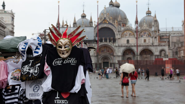 T-shirt stand on St. Mark's Square, with St. Mark's Basilica, Venice, Italy
