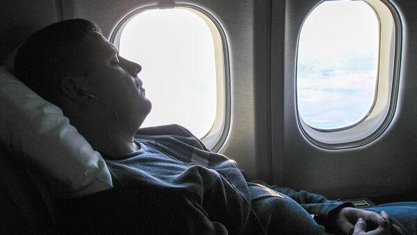 Airplane passenger sleeping