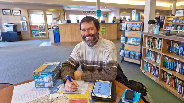 Customer doing research at Rick Steves' Europe in Edmonds, Washington