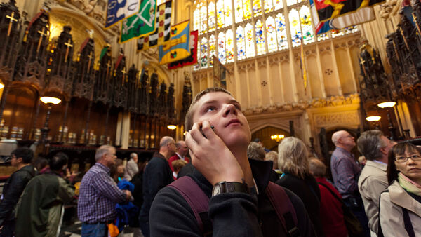 Boy listening to an audio tour in Westminster Abbey, London, England