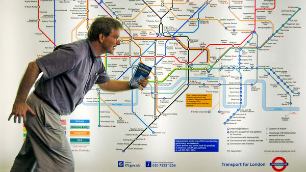 Rick Steves in front of a Tube map, London, England