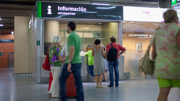Information booth at train station, Madrid, Spain