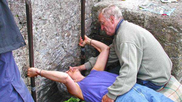 Kissing the Blarney Stone, Blarney Castle, Ireland