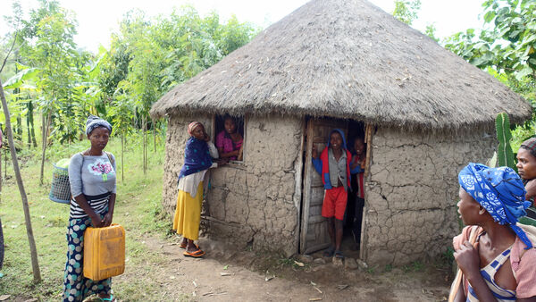 People gathered at a village hut in Ethiopia