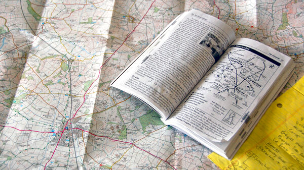 Guidebook open on top of map