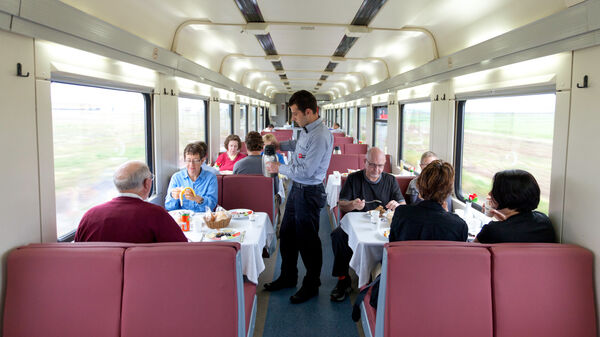 Passengers in dining car on train