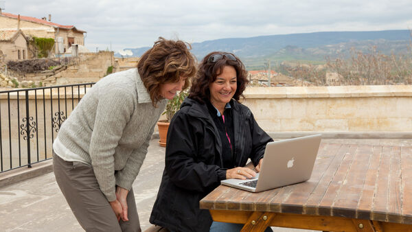 Women using laptop computer, Cappadocia, Turkey