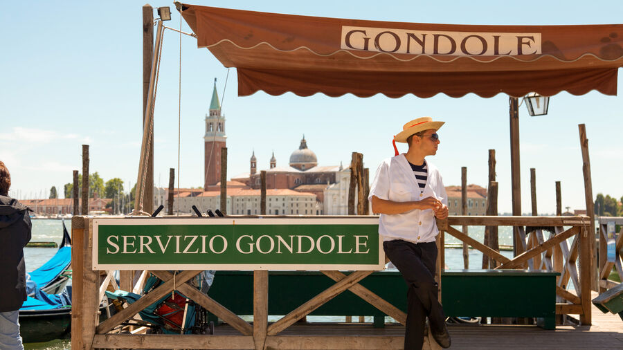 Gondola stand and gondolier, Venice, Italy