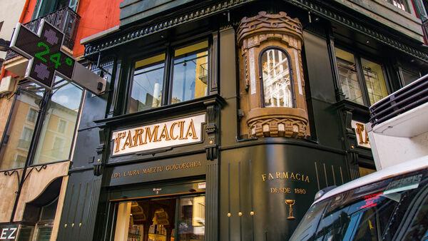 Sign for pharmacy, Pamplona, Spain
