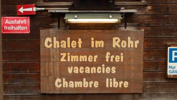 Hotel sign in multiple languages, Switzerland