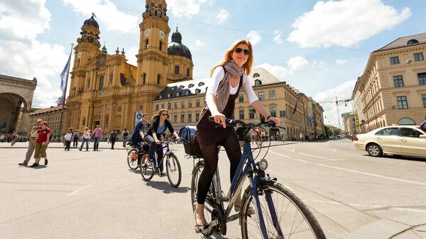 Bicyclists in Odeonsplatz, Munich, Germany
