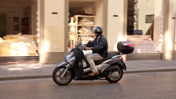 Vespa driver, Florence, Italy