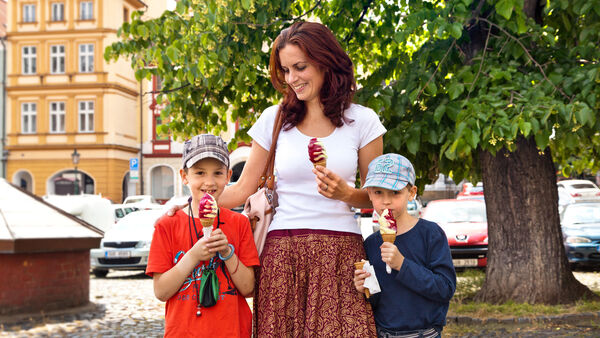 Mother with children eating ice cream cones