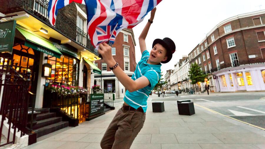 Boy waving British flag, London, England