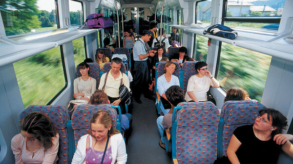 Passengers in second class car on train