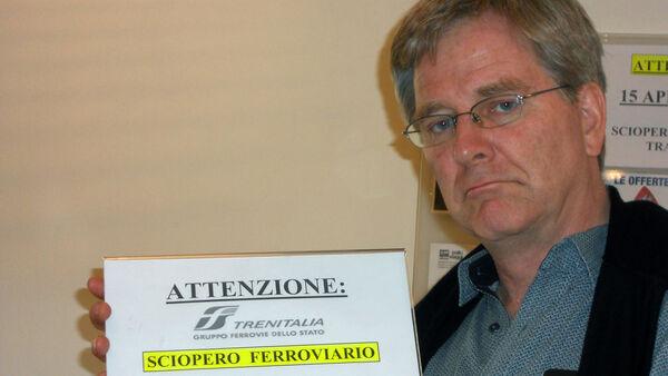 Rick Steves holding Trenitalia rail strike notice