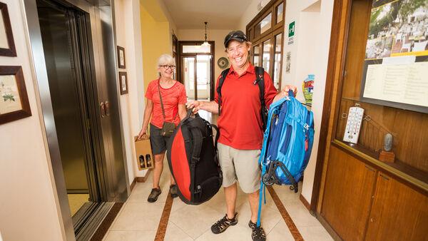 Travelers carrying backpacks
