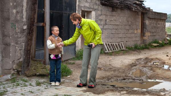 Woman shaking hand with boy, Cappadocia, Turkey