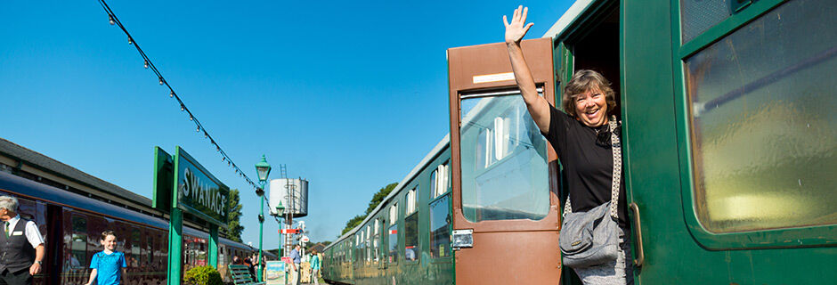 Waving from a train