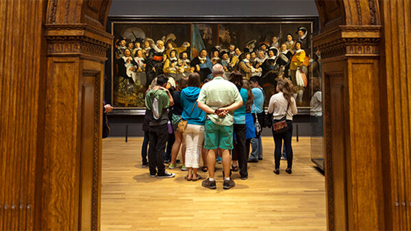 """Rijksmuseum visitors absorbed by Rembrandt's """"Night Watch"""" painting"""