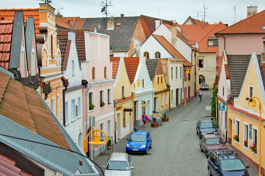 Row of medieval buildings with Baroque pastel facades in Trebon, Czech Republic