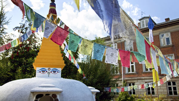 Tibetan stupa and prayer flags in the middle of Copenhagen's Christiania enclave