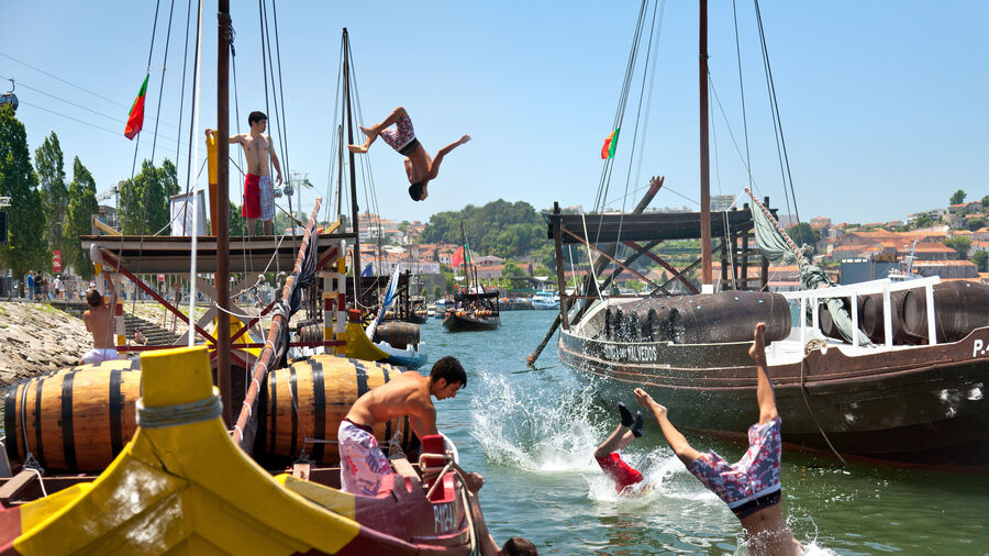 Swimmers along Cais da Ribeira, Porto