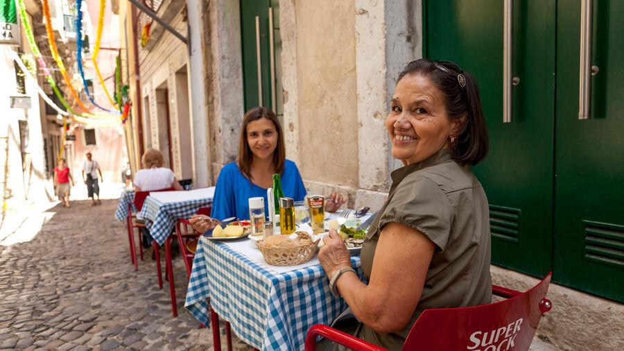 Sidewalk café in Alfama neighborhood, Lisbon
